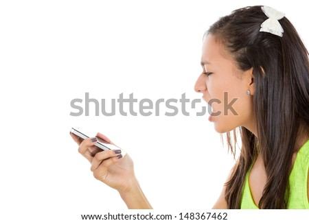 Close-up, cropped portrait of a frustrated angry young woman yelling on her phone, isolated on a white background with copy space  - stock photo