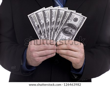 Close-up cropped shot of a businessman holding fan of US dollar. - stock photo