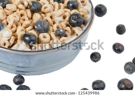 Close-up cropped shot of breakfast bowl with cereal and red grapes. - stock photo