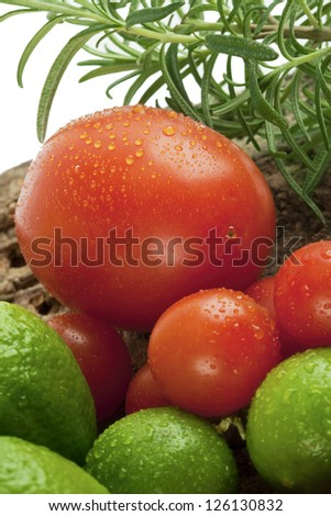 Close-up cropped shot of wet tomatoes and guava in basket. - stock photo