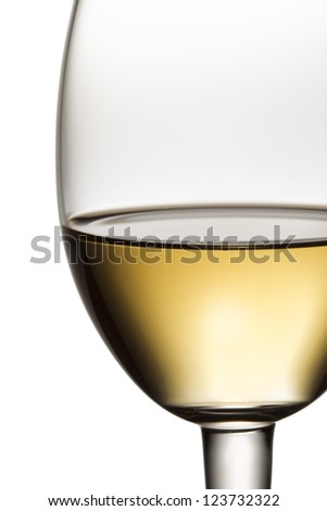 Close-up cropped shot of wine glass with white wine. - stock photo