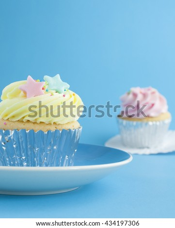 Close up cup cake on blue background - stock photo