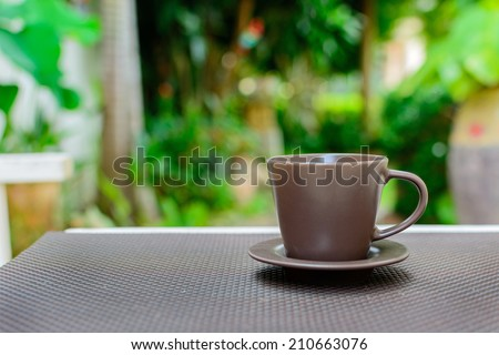 Close up cup of coffee in the garden