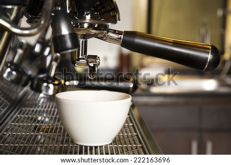 Close up cup of coffee machine prepares espresso in coffee shop
