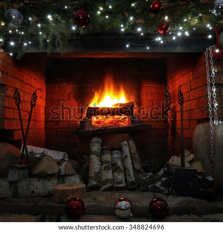 close-up decorated christmas fireplace with lights at night
