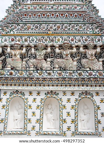 close-up decoration ornament details of famous historic buddhism stupa in WAT ARUN, BANGKOK, THAILAND showing variety figure characters from RAMAYANA myth supporting around the stupa base