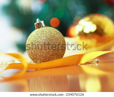 Close up decorative ball on the background of Christmas tree. - stock photo