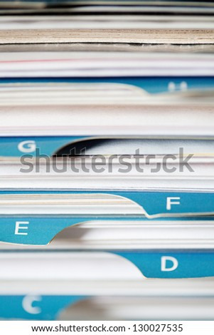 Close detail business card holder full stock photo royalty free close up detail of a business card holder with full of business cards with paper tag colourmoves