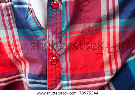 Close up detail of a red plaid button up style shirt. - stock photo