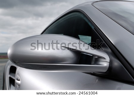 Close up detail of a silver car - stock photo