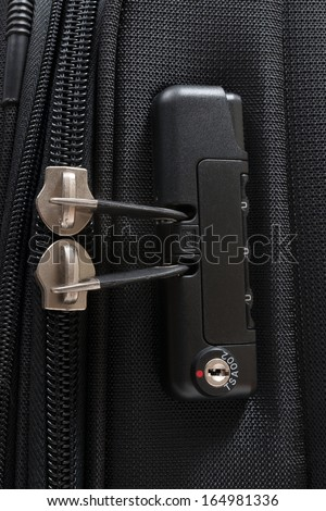 Close up detail of a TSA accepted luggage lock - stock photo