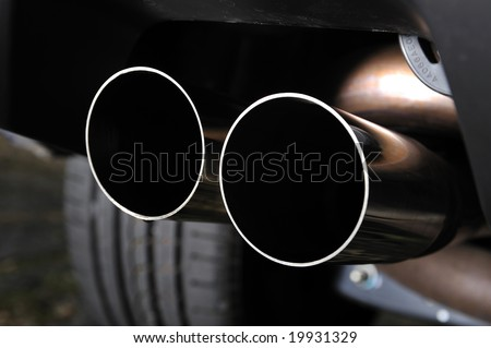 Close up detail of a twin exit tail pipe - stock photo