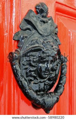 Close up Detail of an Ornate Metal Door Knocker - stock photo
