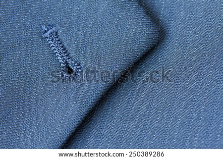 Close up detail of buttonhole on suit lapel - stock photo