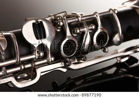 close up detail of clarinet on gray background - stock photo