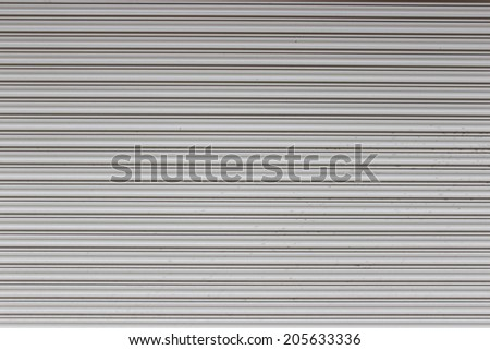 Close-up detail of closed metal security shutter - stock photo