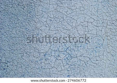 Close-up detail of cracked paint on metal wall. - stock photo