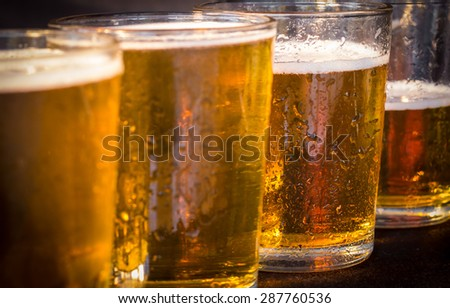 Close up detail of glasses of beer - stock photo