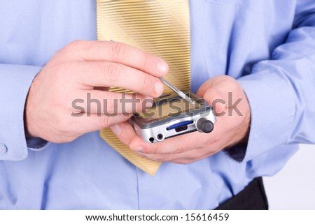 Close-up detail of the hands of a businessman tapping on a pda computer - stock photo