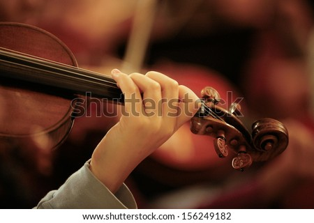 Close up detail of Violin being played in Orchestra