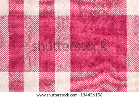 Close up detail view of a patterned cotton kitchen cloth with visible weave and bright color checks. - stock photo