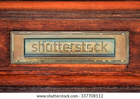 Close-up details of an aged post sign on a door.   - stock photo
