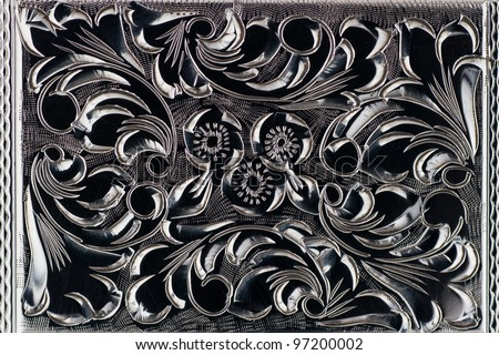 Close up details of engraved  of an old cigarette case - stock photo