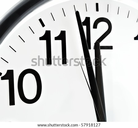 Close up dial of hours, two minutes to twelve - stock photo