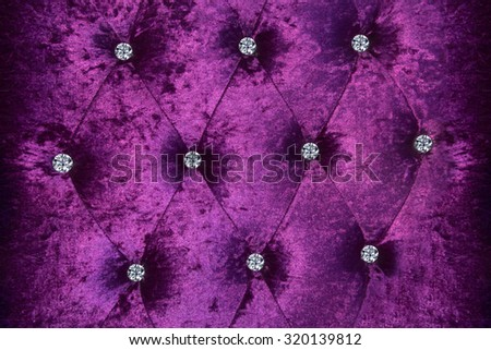 close up diamond on leather texture in violet concept - stock photo