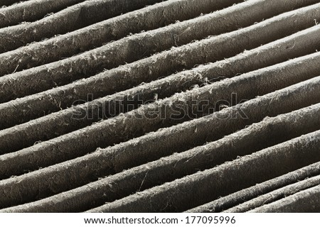 Close up dirty car air conditioner filter isolated on white - deep focus image - stock photo
