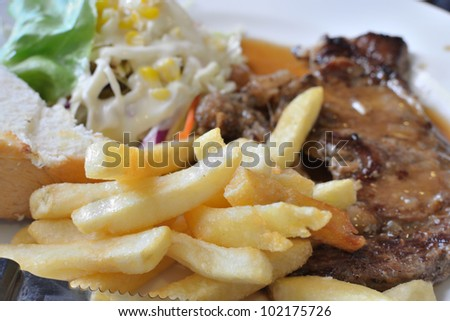 close up dish of pork steak.