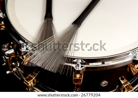 close up drum with drumsticks on black background - stock photo