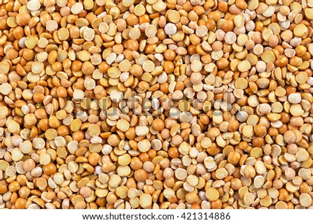 Close up dry yellow split peas background