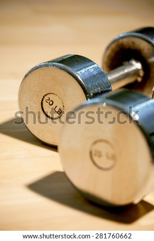 Close up  dumbbells on the floor - stock photo