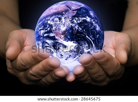 Close up earth globe in the man palm. Photo earth from NASA satellite
