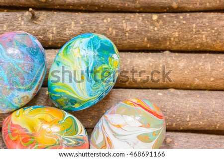 close up Easter eggs on wood pattern background