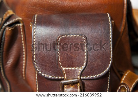 close up elements of rough brown leather bag - stock photo
