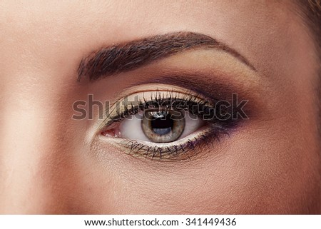 Close up eye with pefect make up and skin. Advertising and comerical for make up products. Eyelashes and eyebrows - stock photo