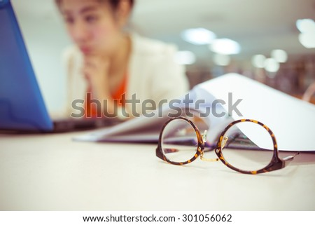 close-up eyeglasses, study education, working woman - stock photo