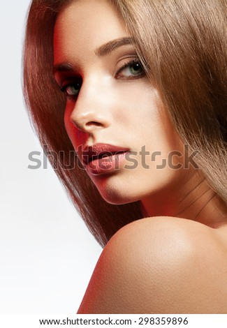 Close-up face beautiful woman with brown hair shining on a white background - stock photo