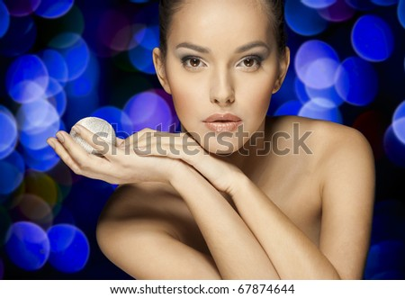 Close-up face of beautiful caucasian brunet woman with brown eyes ower night light. Studio shot - stock photo