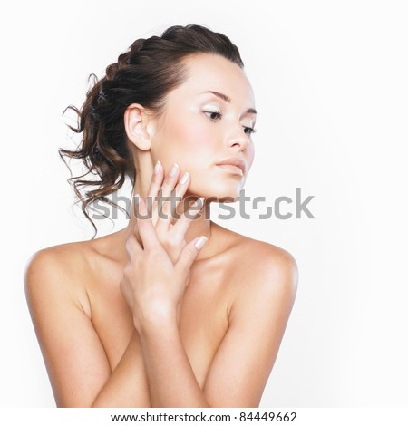 Close-up face of beautiful woman with clean fresh healthy skin - stock photo