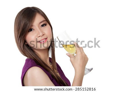 Close up face of beautiful young Asian woman leaning back her head and looking to camera while holding a glass of champagne, isolated on white background