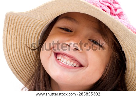 close up face of happy, smiling female asian caucasian kid playing - stock photo
