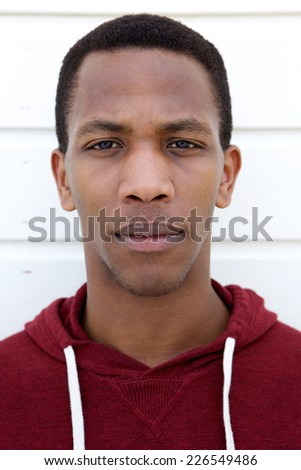 Close up face portrait of a young african man - stock photo