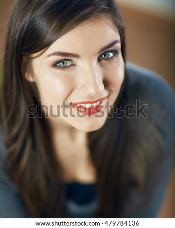 Close up face portrait of smiling girl. Beautiful eyes. Long hair.