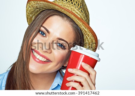 Close up face portrait of young smiling woman hat wearing holding coffee cup. White background isolated. - stock photo