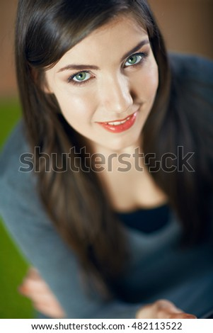 Close up face portrait  with small depth of field.Young smiling woman. Beautiful eyes. Long hair.