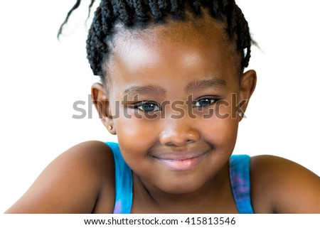 Close up face shot of cute smiling african girl with braided hair isolated against white background.  - stock photo