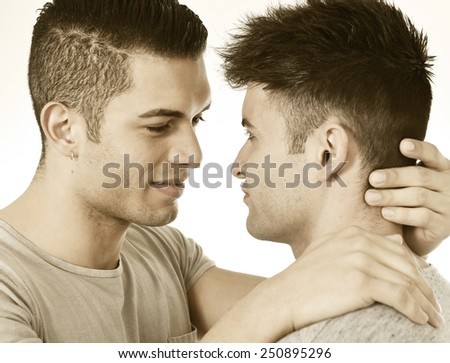 close up faces and expression of happy gay homosexual couple of young attractive and handsome men in love kissing wearing casual clothes isolated on white   - stock photo